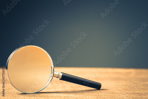 Photo Magnifying Glass on Wood Background