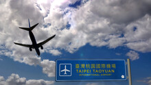 Plane Landing In Taipei Taoyuan Taiwan Airport With Signboard