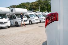 Line Of Brand New Camper Vans Motorhomes Awaiting Clients On Dealership Sales Lot. Recreational Vehicles Selling. Caravanning Industry.