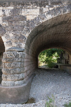 Arched Stone Bridge Over A Dry...