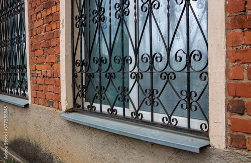 The fa ade on the side. Windows with iron bars with the ligature Canvas Print