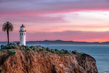 Lighthouse And Sunset