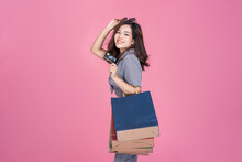 Asian Woman Online Shopping Bag Promotion Sales Using Credit Card Purchasing Products Online Transaction Payment Happy Smiling Beautiful Attractive One Person, Model Studio Pink Isolated Background