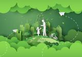 Fototapeta Miasto - green city with family