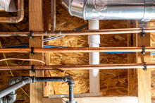 Residential Utility Room With Gas, Water, Sewer, And Electrical Conduit