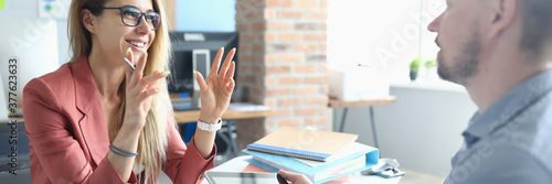 Obraz Two adult business people make work interview against office background.One on one meeting concept. - fototapety do salonu