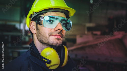 Fototapeta Factory worker use future holographic screen device to control manufacturing machine in factory . Concept of futuristic automation technology , virtual augmented reality and smart visualization . obraz