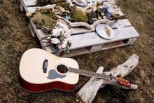 Acoustic Guitar On The Grass A...