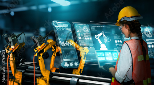 Fototapeta Smart industry robot arms for digital factory production technology showing automation manufacturing process of the Industry 4.0 or 4th industrial revolution and IOT software to control operation . obraz