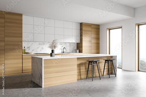 White and wooden kitchen corner with bar