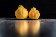 Two Yellow Pumpkin On Black Wo...