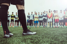 Detail Of Footballer Foots Against Group Of Boys During A Training