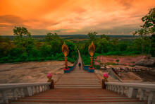 The Background Of A Bridge Or A Walkway To Admire The Mountain Scenery Resembles A Phaya Naga Mortgage Statue, (Wat Phra Bat Phu Pan Kham) In Khon Kaen Province, Thailand.