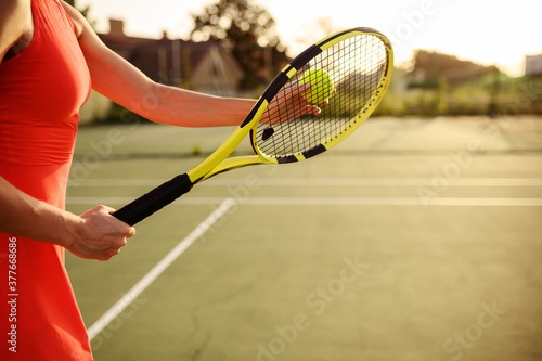 Fototapeta Female tennis player with racket and ball