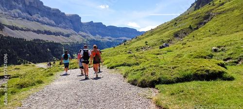 Group of backpackers, people hiking and trekking in Ordesa national park, Pyrenees, Spain