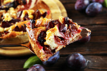 Rustic Plum Cake On Wooden Bac...