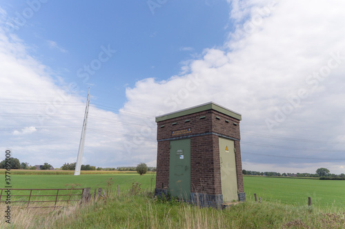 Electrical building with power lines in the background