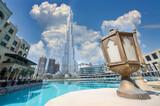 Burj Khalifa with Dubai mall next to it and water reflection of the skycraper in Dubai.