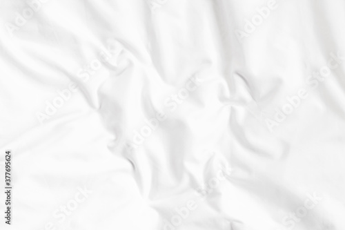 Foto White bed linen background with copy space.