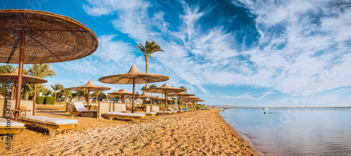 Fotografie, Tablou Relax under parasol on the beach of Red Sea, Egypt