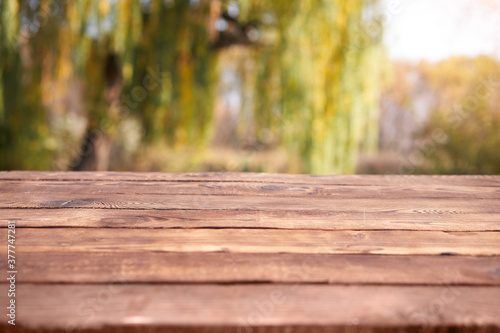 Empty wooden table nature bokeh background with a country outdoor theme,Template Fotobehang