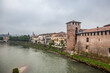View from the Scaliger bridge of the Adige river, the Old castle, the bell tower of the Cathedral and the Cathedral of St. Anastasia in Verona. Veneto, Italy