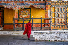 Bhutan, Paro, Inside Rinpung Dzong. Silhouette Of A Monk In His Red Dress .