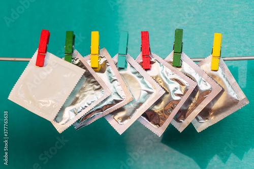 condom and sealed condoms, contraception day concept