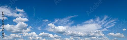 Fotografia White cumulus clouds in blue sky panoramic high resolution background