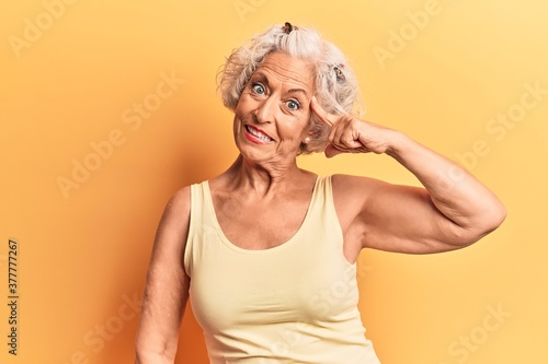 Fotografie, Obraz Senior grey-haired woman wearing casual clothes smiling pointing to head with on