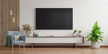Smart TV On The White Wall In Living Room With Armchair,minimal Design.