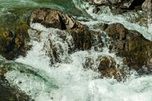Water Splashing Over Rocks