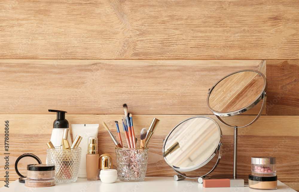 Fototapeta Set of decorative cosmetics and mirrors on dressing table