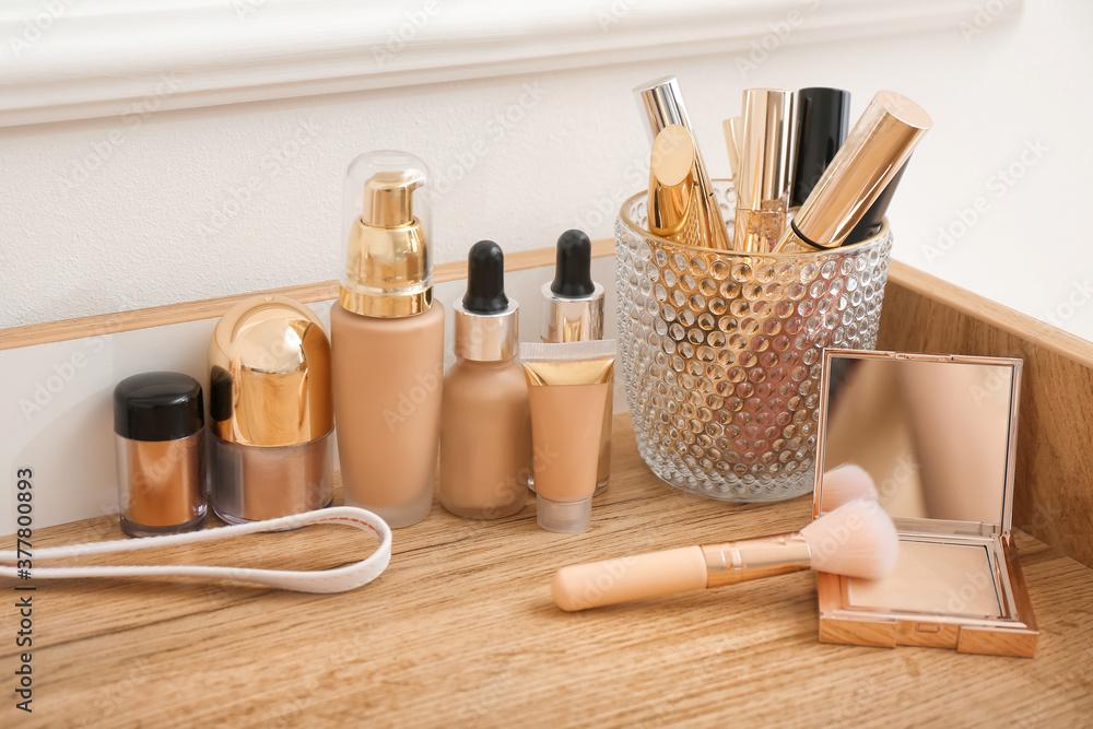 Fototapeta Set of decorative cosmetics on dressing table