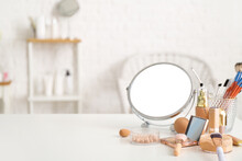 Set Of Decorative Cosmetics And Mirror On Dressing Table