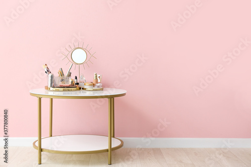 Set of decorative cosmetics on dressing table in room
