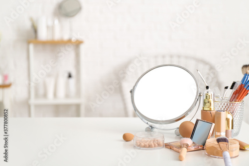 Fotografie, Obraz Set of decorative cosmetics and mirror on dressing table