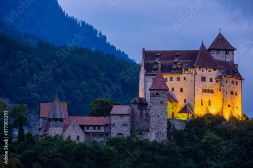 Stampa su Tela Night view of illuminated medieval Gutenberg Castle on hilltop in Balzers villag