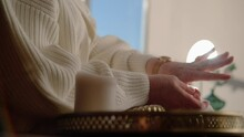 Senior Woman Takes A Ring From Golden Tray And Puts On It On Finger