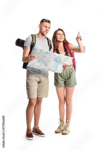 Couple of tourists with map on white background