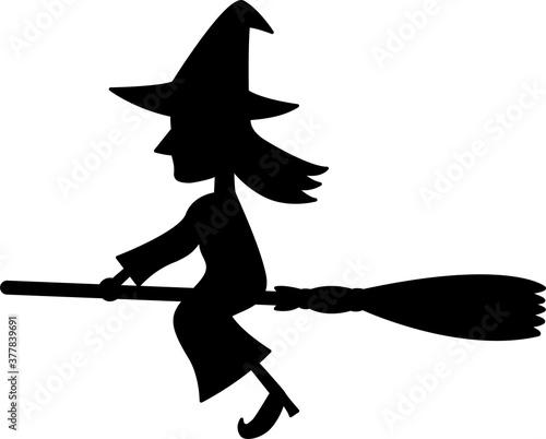 Photographie ほうきで空を飛ぶ魔女のシルエット