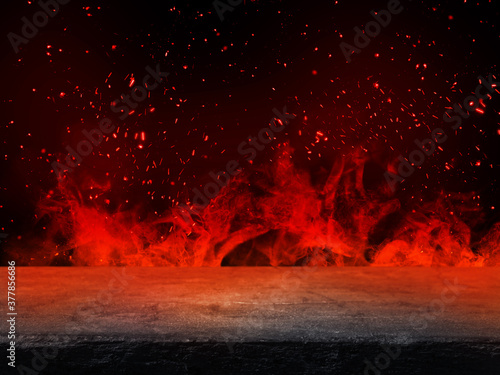 Obraz Side view of Empty stone table top with orange fire or flame and sparkles in dark room. - fototapety do salonu