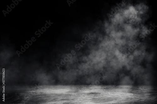 Obraz Empty space of Studio dark room with spot lighting and white smoke in black background.  - fototapety do salonu