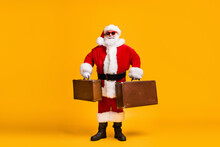 Full Length Photo Of Santa Claus With Beard X-mas Christmas Eve Travel Rest Hold Luggage Wear Red Headwear Cap Sunglass Isolated Over Bright Shine Color Background