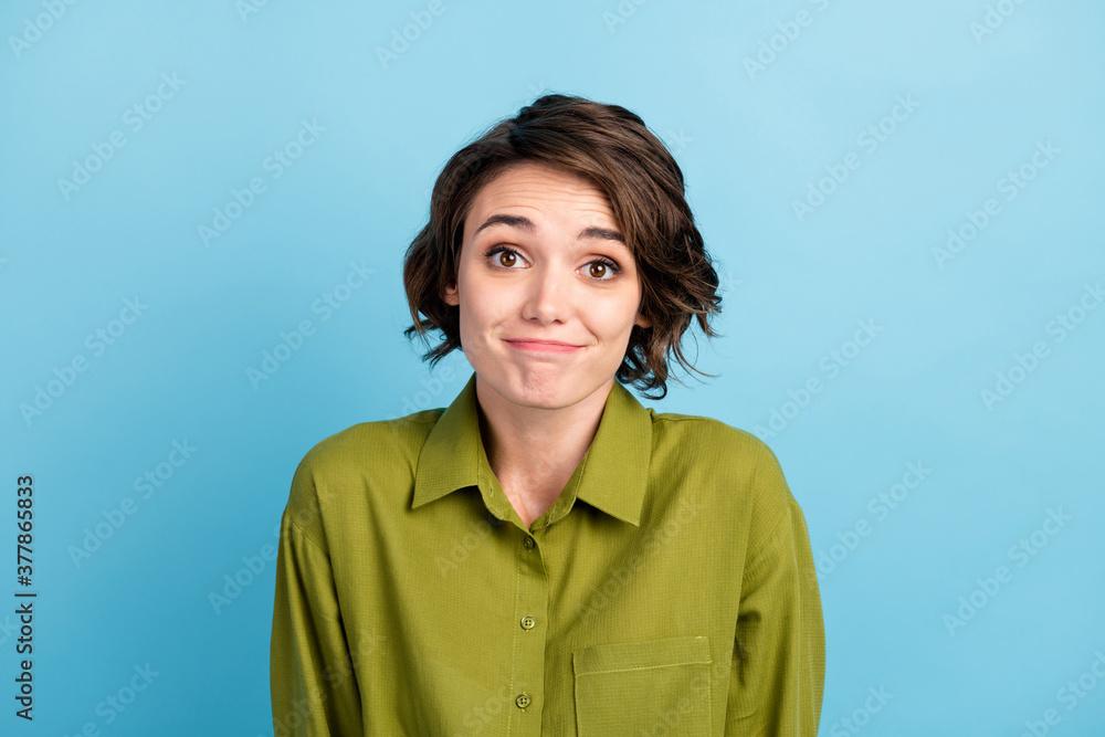 Leinwandbild Motiv - deagreez : Photo of cute funny lovely lady short hairstyle childish guilty look camera girlish face wear green shirt isolated blue color background