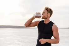 Image Of Young Athletic Sportsman Drinking Protein Shake