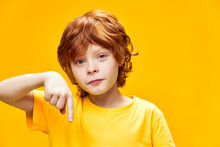 Red-haired Child Gestures With...
