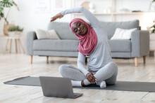Home Training. Black Muslim Wo...