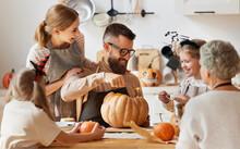 Multi Generational Family Making Jack O Lantern.
