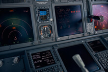 Airplane Cockpit With Flight Displays, Switches And Knobs